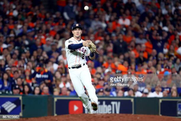 Alex Bregman of the Houston Astros throws to first base for the out in the third inning during Game 4 of the 2017 World Series against the Los...