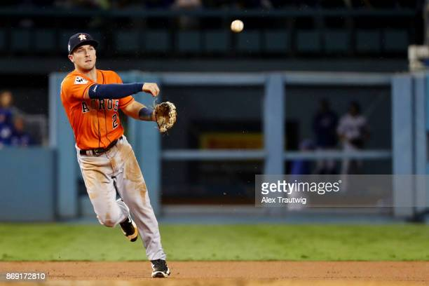 Alex Bregman of the Houston Astros throws to first base for the out in the second inning during Game 7 of the 2017 World Series against the Los...