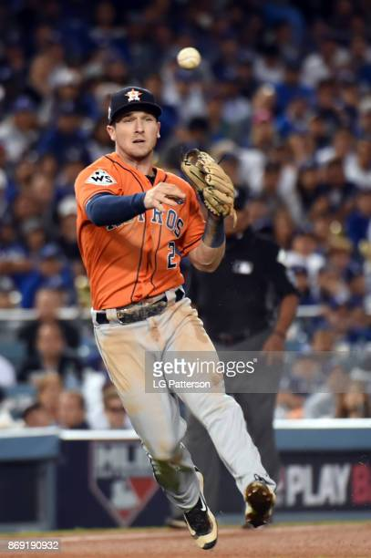 Alex Bregman of the Houston Astros throws to first base for the out during Game 7 of the 2017 World Series against the Los Angeles Dodgers at Dodger...