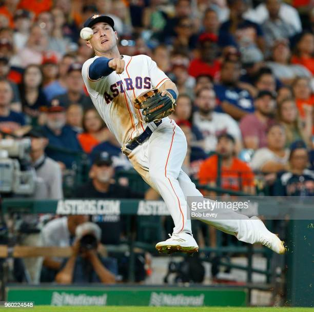 Alex Bregman of the Houston Astros throws to first base in an attempt to throw out Jose Ramirez of the Cleveland Indians in the fifth inning at...