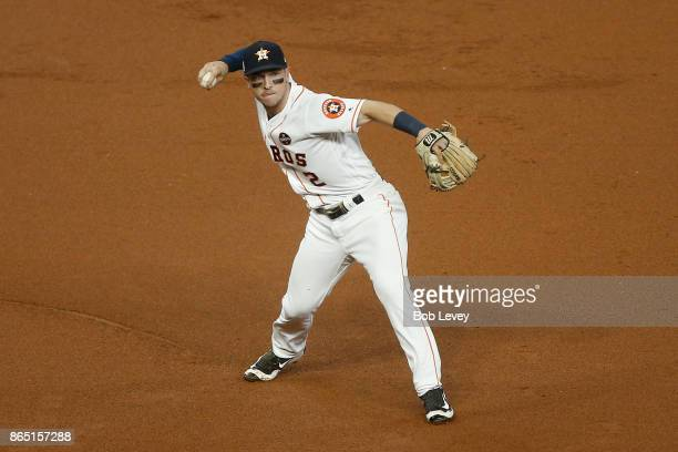 Alex Bregman of the Houston Astros throws to first base in Game Seven of the American League Championship Series against the New York Yankees at...