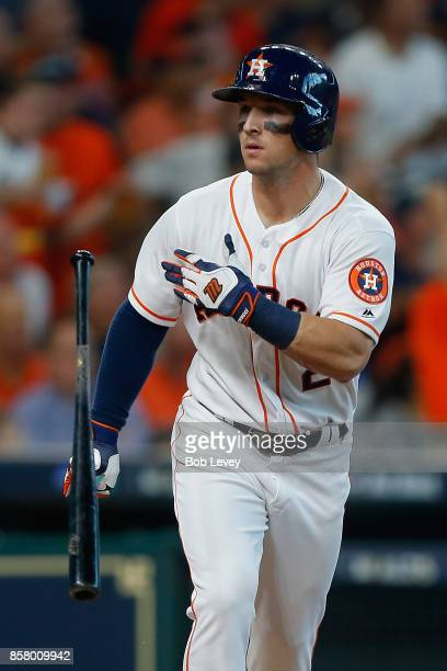 Alex Bregman of the Houston Astros tosses his bat after hitting a home run in the first inning against the Boston Red Sox during game one of the...