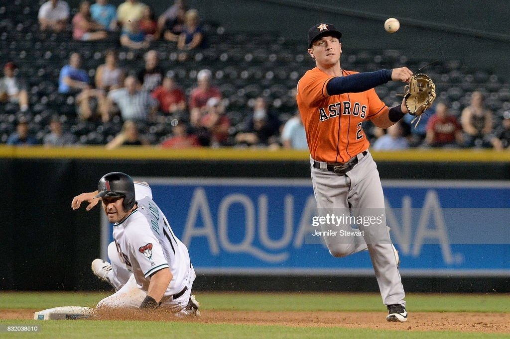 Alex Bregman #2 of the Houston Astros turns a double play over over the sliding A.J. Pollock #11 of the Arizona Diamondbacks in the seventh inning at Chase Field on August 15, 2017 in Phoenix, Arizona.