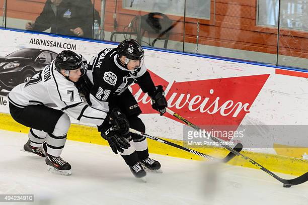 Alex Breton of the Gatineau Olympiques challenges Samuel Tremblay of the BlainvilleBoisbriand Armada during the QMJHL game at the Centre d'Excellence...