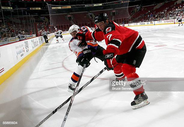 Alex Brooks of the Albany River Rats puts the glove into Eric Meloche of the Philadelphia Phantoms on October 9 2005 at the Wachovia Center in...
