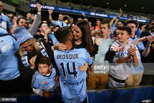 Alex Brosque captain of Sydney FC celebrates with his wife Nadia Brosque after victory in the 2017 ALeague Grand Final match between Sydney FC and...