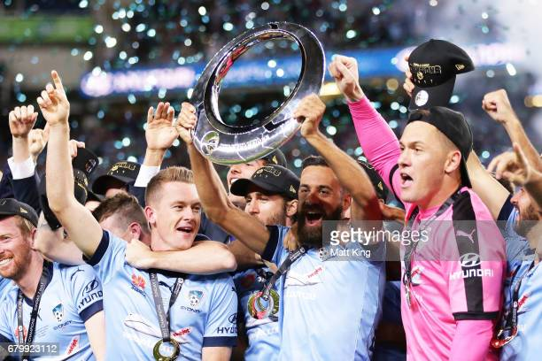 Alex Brosque captain of Sydney FC holds aloft the A-League trophy and celebrates with team mates during the 2017 A-League Grand Final match between...