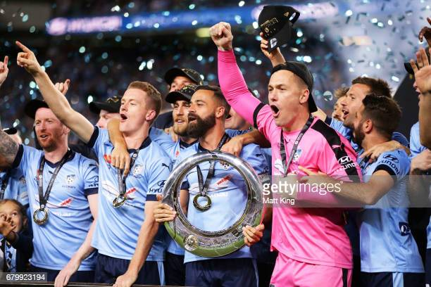 Alex Brosque captain of Sydney FC holds aloft the ALeague trophy and celebrates with team mates during the 2017 ALeague Grand Final match between...