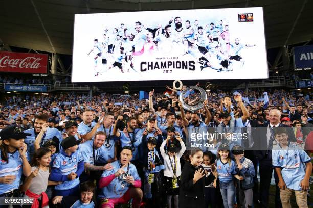 Alex Brosque captain of Sydney FC holds aloft the ALeague trophy in front of The Cove after the 2017 ALeague Grand Final match between Sydney FC and...