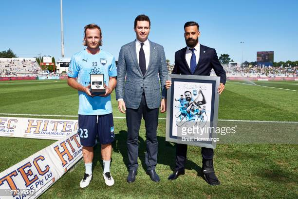 Alex Brosque is presented an award for 250 Sydney FC Games and Rhyan Grant of Sydney is presented an award for becoming Sydney FC's first 10 year...