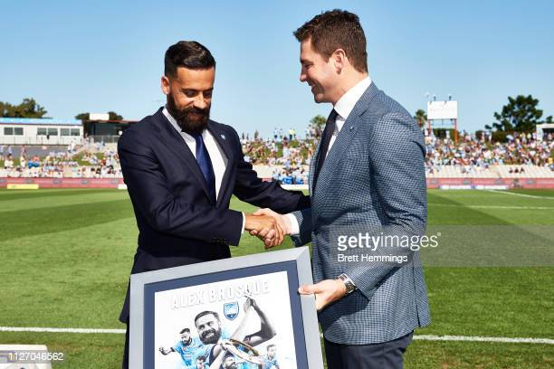 Alex Brosque is presented an award for 250 Sydney FC Games during the round 17 ALeague match between Sydney FC and Melbourne City at WIN Jubilee...