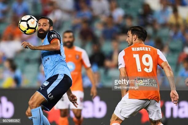 Alex Brosque of Sydney and Jack Hingert of Brisbane contest the ball during the round 23 ALeague match between Sydney FC and the Brisbane Roar at...