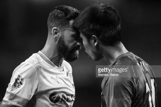 Alex Brosque of Sydney butts heads with Sun Kai of Shanghai Shenhua FC during the AFC Champions League match between Sydney FC and Shaghai Shenhua at...