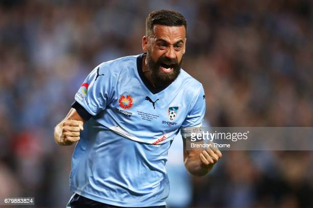 Alex Brosque of Sydney celebrates after team mate Rhyan Grant scores a goal during the 2017 ALeague Grand Final match between Sydney FC and the...