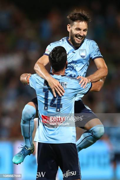Alex Brosque of Sydney celebrates scoring a goal with team mate Milos Ninkovic of Sydney during the round 11 ALeague match between Sydney FC and the...