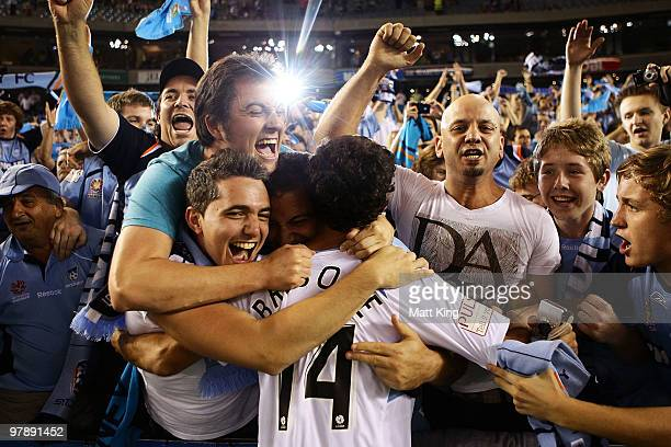 Alex Brosque of Sydney celebrates with fans after victory in the ALeague Grand Final match between the Melbourne Victory and Sydney FC at Etihad...