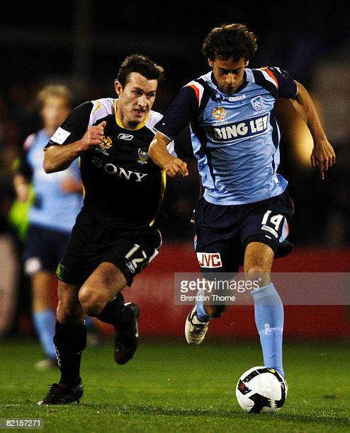 Alex Brosque of Sydney competes with Richard Johnson of Wellington during the A-League Pre-Season Cup match between Sydney FC and the Wellington...
