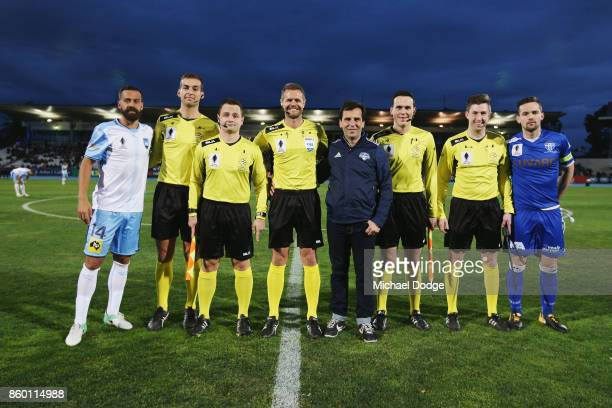 Alex Brosque of Sydney FC and Matthew Foschini of South Melbourne pose with umpires during the FFA Cup Semi Final match between South Melbourne FC...