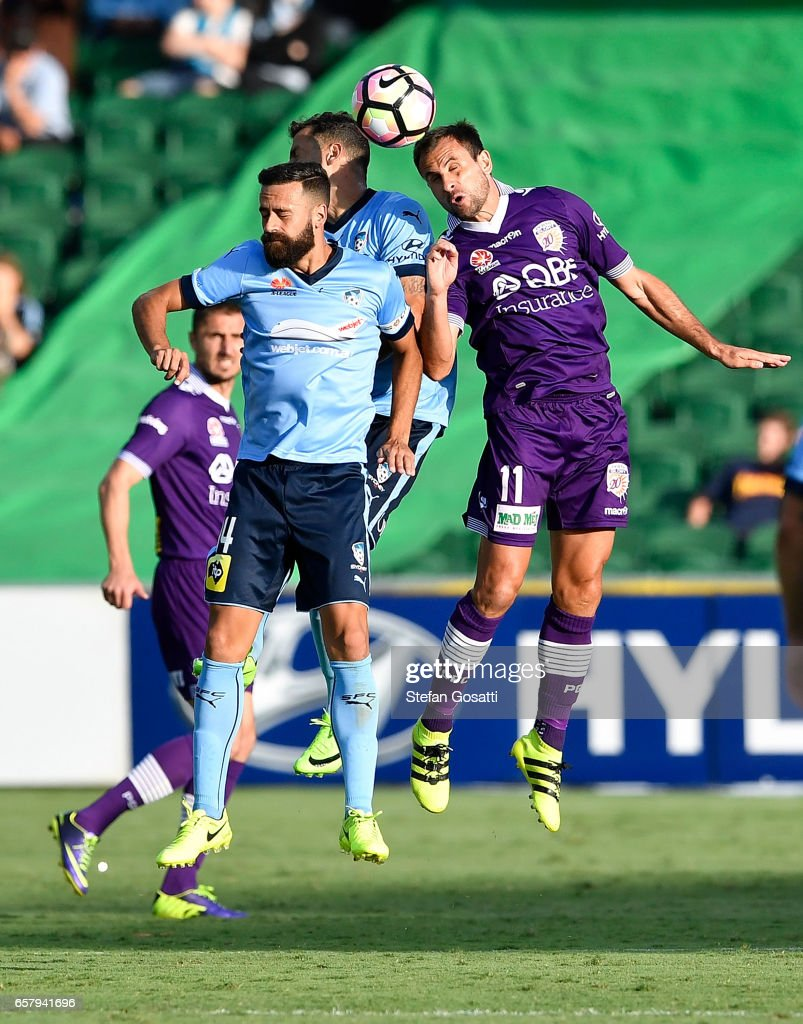 Alex Brosque of Sydney FC and Richard Garcia of the Glory contest a header during the round 24 A-League match between Perth Glory and Sydney FC at nib Stadium on March 26, 2017 in Perth, Australia.