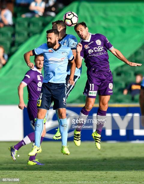 Alex Brosque of Sydney FC and Richard Garcia of the Glory contest a header during the round 24 ALeague match between Perth Glory and Sydney FC at nib...