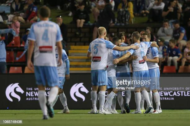 Alex Brosque of Sydney FC celebrates his goal with team mates during the round four ALeague match between the Newcastle Jets and Sydney FC at...