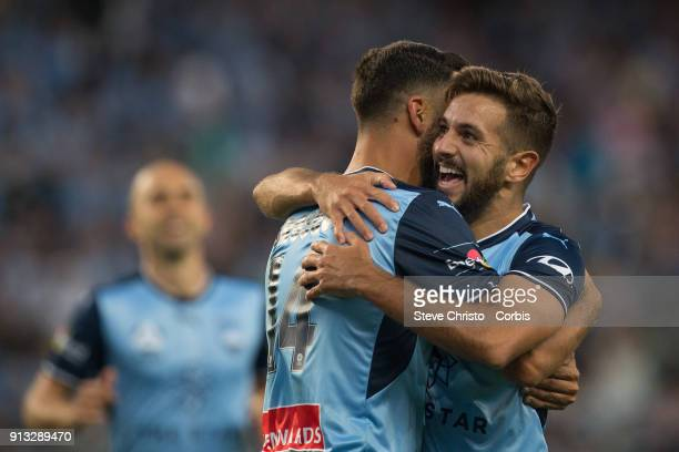 Alex Brosque of Sydney FC celebrates scoring a goal with Michael Zullo (r) and Adrian Mierzejewski during the round 19 A-League match between Sydney FC and the Wellington Phoenix at Allianz Stadium on February 2, 2018 in Sydney, Australia.