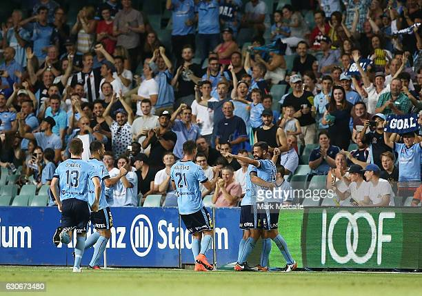 Alex Brosque of Sydney FC celebrates scoring a goal with team mates during the round 13 ALeague match between Sydney FC and Brisbane Roar at Allianz...