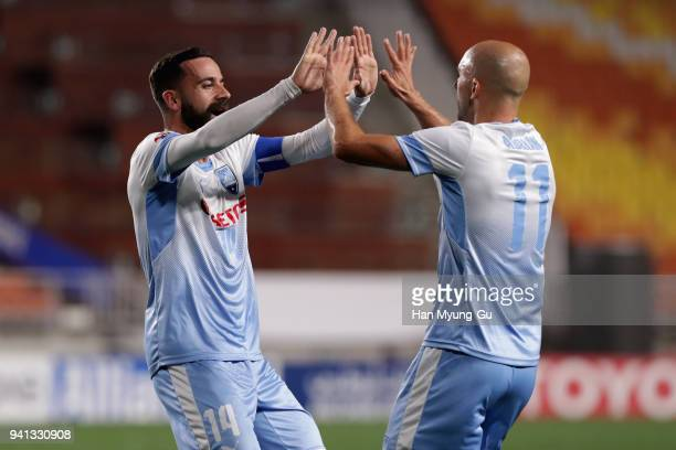 Alex Brosque of Sydney FC celebrates scoring his side's second goal with his team mate Adrian Mierzejewski during the AFC Champions League Group H...