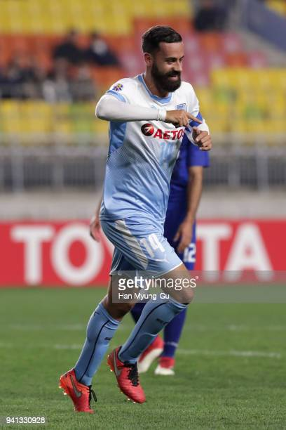 Alex Brosque of Sydney FC celebrates scoring his side's second goal during the AFC Champions League Group H match between Suwon Samsung Bluewings and...