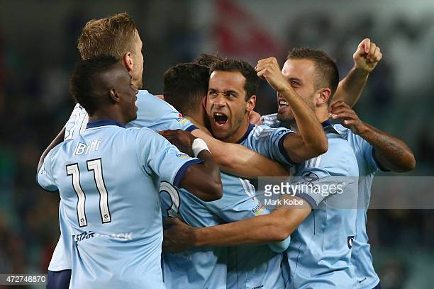 Alex Brosque of Sydney FC celebrates with his team mates after scoring a goal during the ALeague Semi Final match between Sydney FC and Adelaide...