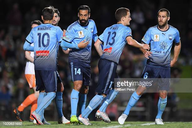 Alex Brosque of Sydney FC celebrates with team mates after scoring a goal during the FFA Cup round of 16 match between Cairns FC and Sydney FC at...