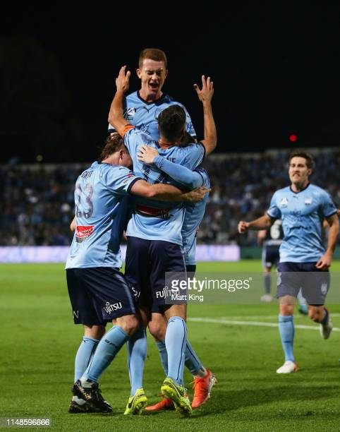 Alex Brosque of Sydney FC celebrates with team mates after scoring a goal as Brandon O'neill jumps over the top during the A-League Semi Final match...