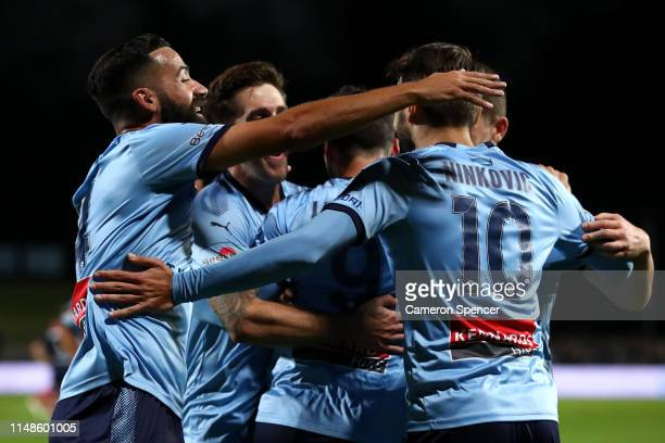 Alex Brosque of Sydney FC congratulates team mate Adam Le Fondre of Sydney FC after scoring a goal during the A-League Semi Final match between...