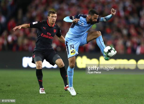 Alex Brosque of Sydney FC controls the ball over Krystian Bielik of Arsenal during the match between Sydney FC and Arsenal FC at ANZ Stadium on July...
