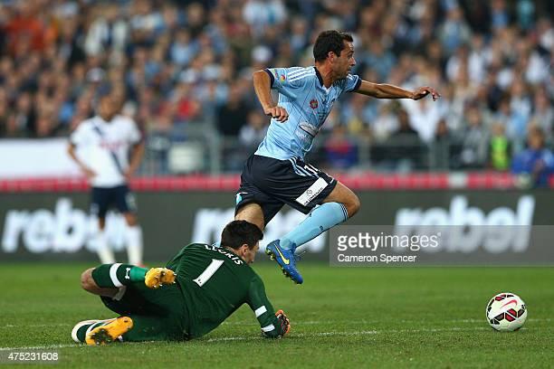 Alex Brosque of Sydney FC dribbles the ball past Hugo Lloris of Hotspurs during the international friendly match between Sydney FC and Tottenham...