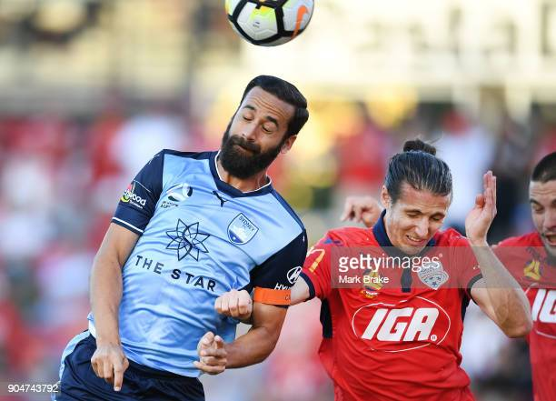 Alex Brosque of Sydney FC heads for goal over Michael Marrone of Adelaide United during the round 16 ALeague match between Adelaide United and Sydney...