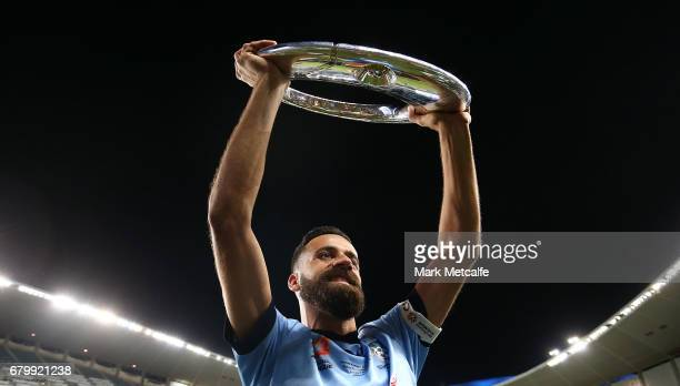 Alex Brosque of Sydney FC holds the trophy aloft after winning the 2017 ALeague Grand Final match between Sydney FC and the Melbourne Victory at...