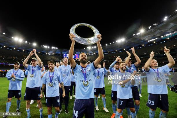 Alex Brosque of Sydney FC holds the trophy aloft for fans after the 2019 ALeague Grand Final match between the Perth Glory and Sydney FC at Optus...