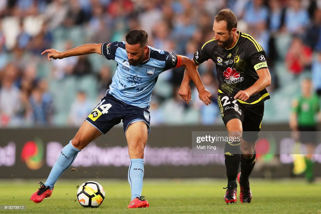 Alex Brosque of Sydney FC is challenged by Andrew Durante of Wellington Phoenix during the round 19 A-League match between Sydney FC and the Wellington Phoenix at Allianz Stadium on February 2, 2018 in Sydney, Australia.