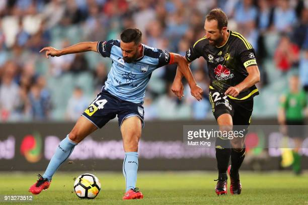 Alex Brosque of Sydney FC is challenged by Andrew Durante of Wellington Phoenix during the round 19 ALeague match between Sydney FC and the...
