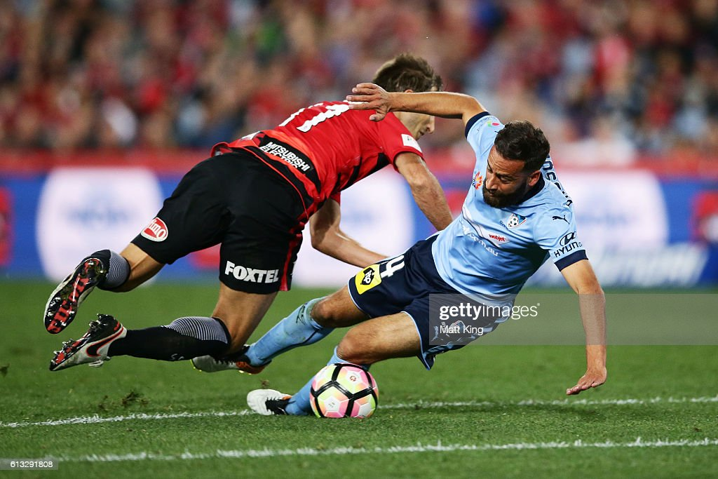 Alex Brosque of Sydney FC is fouled by Aritz Borda of the Wanderers before a penalty was awarded to Sydney FC during the round one A-League match between the Western Sydney Wanderers and Sydney FC at ANZ Stadium on October 8, 2016 in Sydney, Australia.