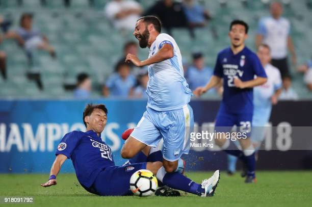 Alex Brosque of Sydney FC is tackled by Kwak KwangSeon of the Bluewings during the AFC Asian Champions League match between Sydney FC and Suwon...