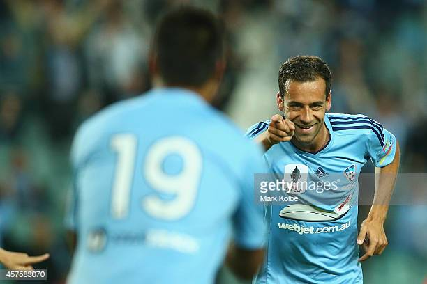 Alex Brosque of Sydney FC points to Nick Carle of Sydney FC as he celebrates after scoring a goal during the FFA Cup Quarter Final match bewtween...