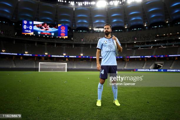Alex Brosque of Sydney FC poses with the ALeague trophy after playing his final ALeague match winning the 2019 ALeague Grand Final match between the...