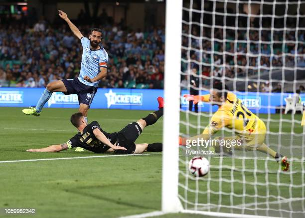 Alex Brosque of Sydney FC scores his teams second goal during the round two ALeague match between Sydney FC and Western Sydney Wanderers at the...