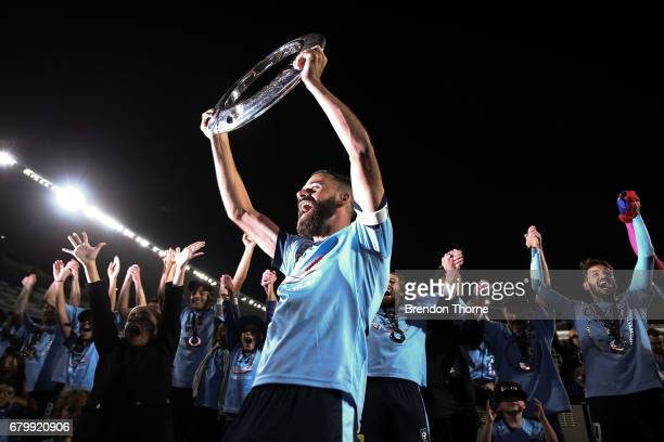Alex Brosque of Sydney lifts the ALeague trophy in front of fans following the 2017 ALeague Grand Final match between Sydney FC and the Melbourne...