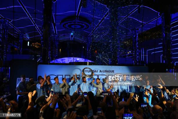 Alex Brosque of Sydney with teammates holds aloft the A-League Trophy during the Sydney FC A-League Grand Final celebrations at The Star on May 20,...
