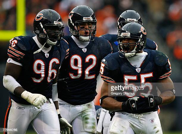 Alex Brown Hunter Hillenmeyer and Lance Briggs of the Chicago Bears celebrate after Briggs stuffed Shaun Alexander of the Seattle Seahawks during...