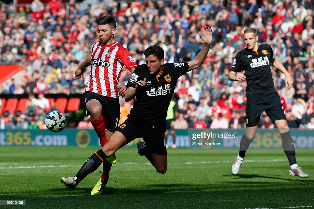 Alex Bruce of Hull City challenges Shane Long of Southampton to concede a penalty during the Barclays Premier League match between Southampton and Hull City at St Mary's Stadium on April 11, 2015 in Southampton, England.