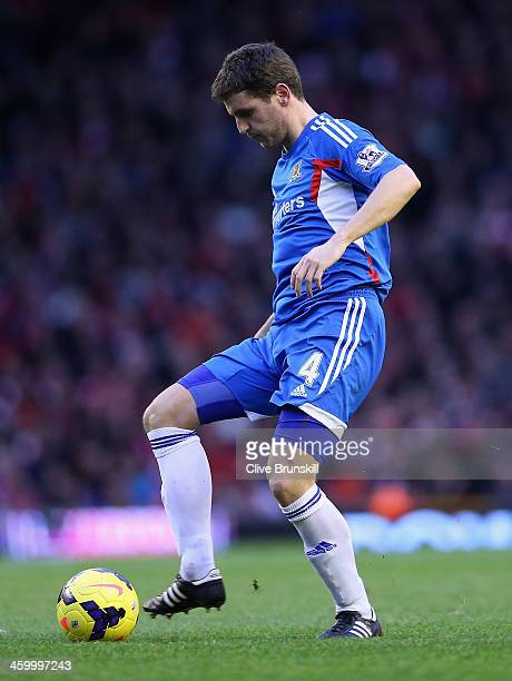 Alex Bruce of Hull City in action during the Barclays Premier League match between Liverpool and Hull City at Anfield on January 1 2014 in Liverpool...